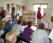 Classroom of people learning firewise techniques