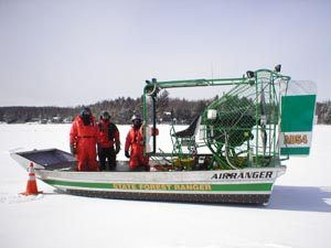 Rangers in an airboat on a frozen lake