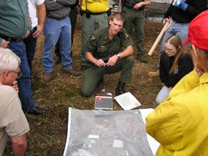 A Ranger and a group of volunteer with a search map