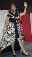 a model wearing a recycled junkmail dress