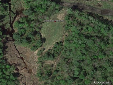 Credit: Google Earth Image. Aerial photo showing the regrowth of vegetation and improvement in the site after well plugging and reclamation.