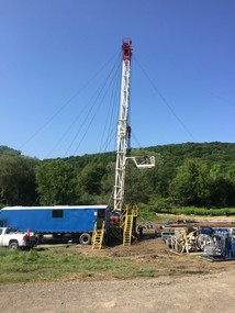 Gas well in poor condition. No wellhead to control flow.