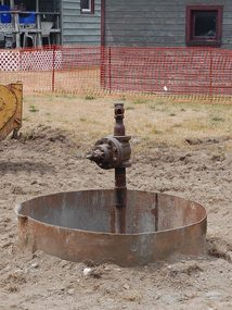 Gas well in poor condition. Line is broken off and the well has leaked brine into the field in which it is located.