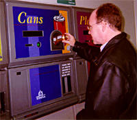A consumer redeeming his empty beverage containers in a reverse vending machine