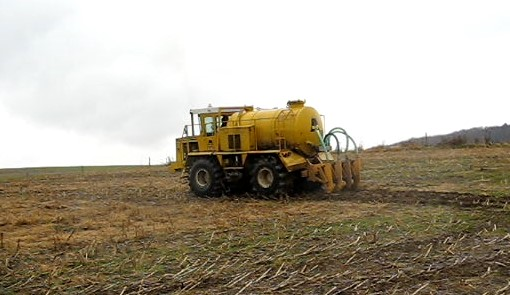 Truck injecting whey into upper layer of soil