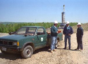 DEC Inspector at drilling site