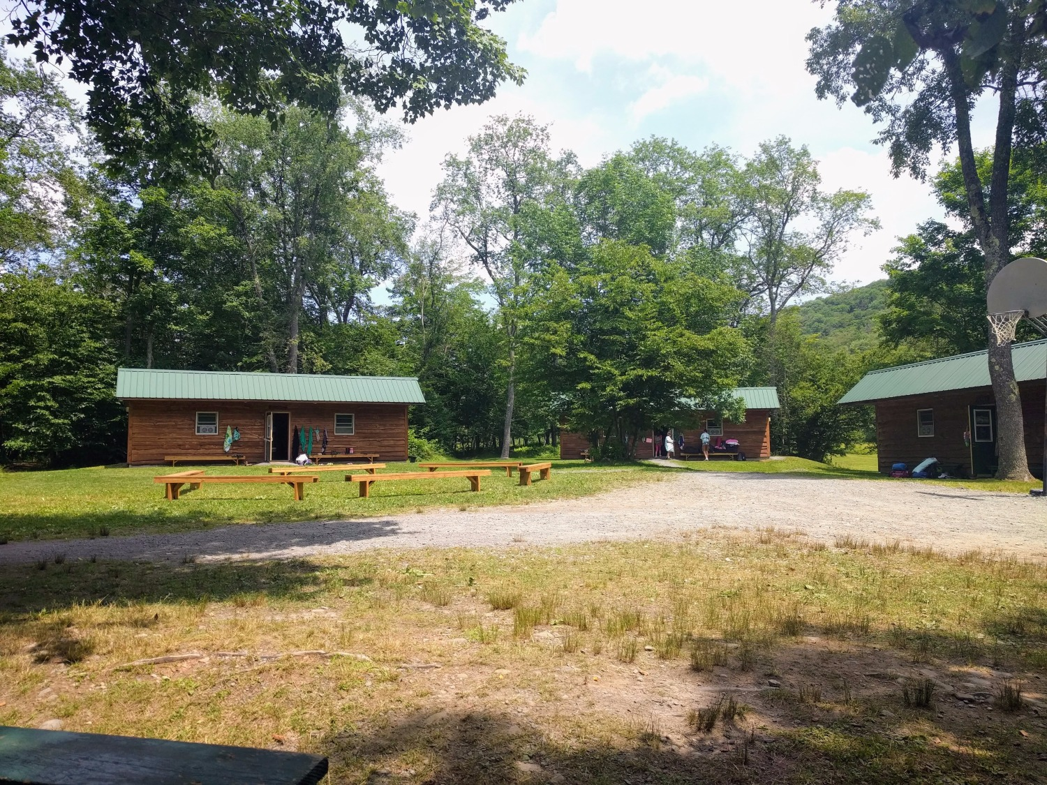 Several cabins at Camp DeBruce sit among the trees