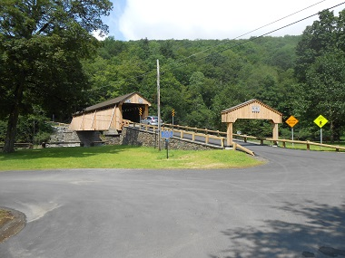 Image of the historic covered bridge that spans the stream along the town road