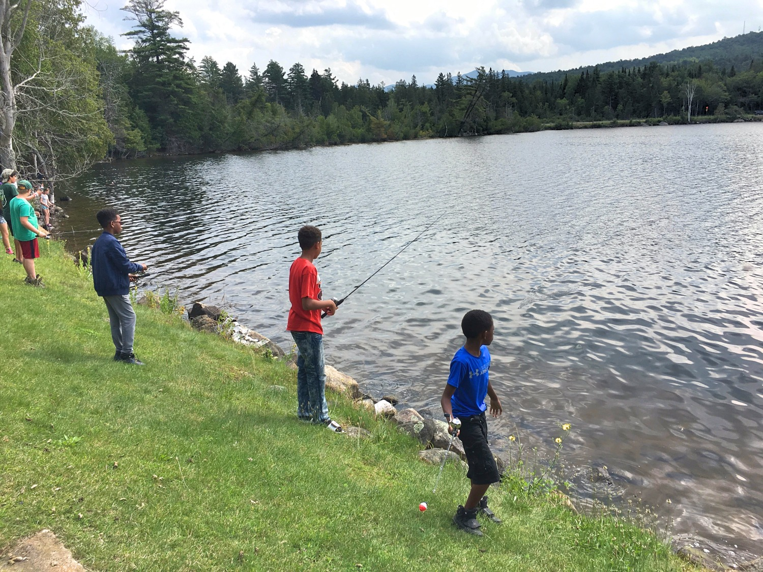 Kids fishing on the shore of Lake colby