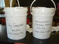 A photo of two five-gallon plastic lidded buckets