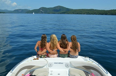 four girls enjoing lake george