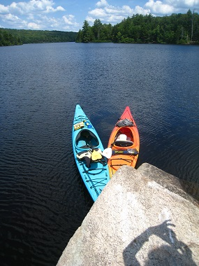 two colorful kayaks in the water