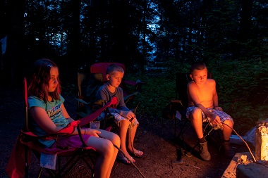 kids around the fire roasting marshmallows