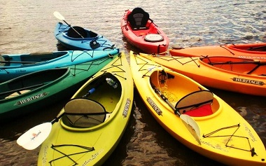 a rainbow of kayaks in a circle