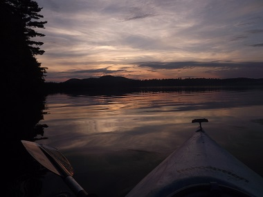 sunset as seen from a kayak on the water