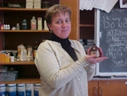 Suzanne Wheatcraft holding a jar containing mercury