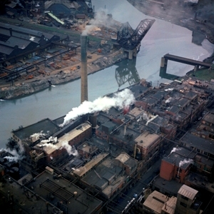 Historic photo of Buffalo River. The former Republic Steel plant is to the left of the river and the former Buffalo Color plant is to the right. Oil sheens visible in the photo indicate petroleum impacts. Most of the contamination is now bound to river sediments.