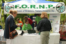 people at FORNP booth