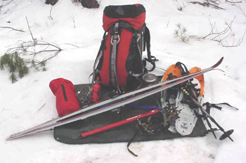backpack, skis, snowshoes, ice axe and other winter gears
