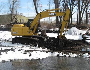 An excavator digs up contaminated soil at the Niagara Transformer site