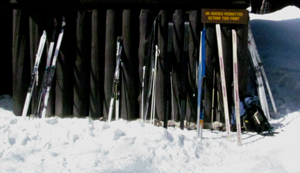Cross country skis leaning agains main lodge.