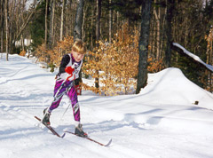 A young boy doing cross-country skiing