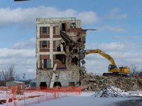 An excavator demolishes a building at the former Spaulding Composites complex in Tonawanda. The site has been completely remediated under the Superfund and Environmental Restoration Programs.