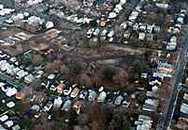 Aerial view of property surrounded by houses
