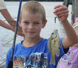 A young boy caught a six inch bluegill sunfish with his fishing pole at Norrie Points 30th annual Science on the River event.