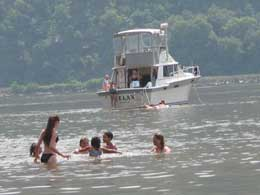 boats and swimmers on the Hudson