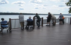 people of all abilities enjoy fishing from a deck