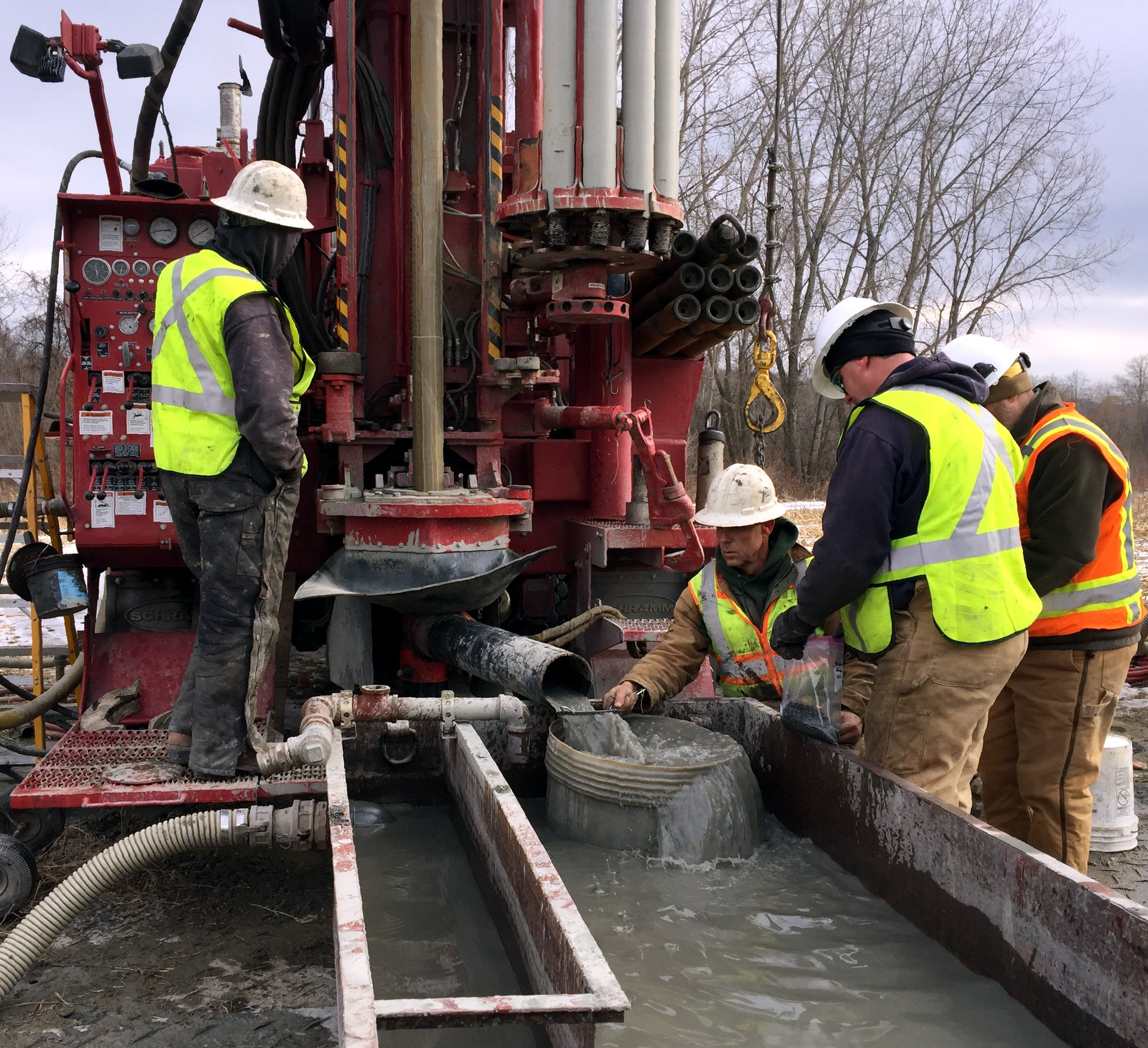 workers drill for groundwater in the Hoosick area