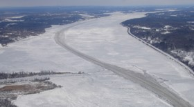 aerial view of the mid Hudson River covered in ice with the cutout channel visible from Saugerties to Germantown