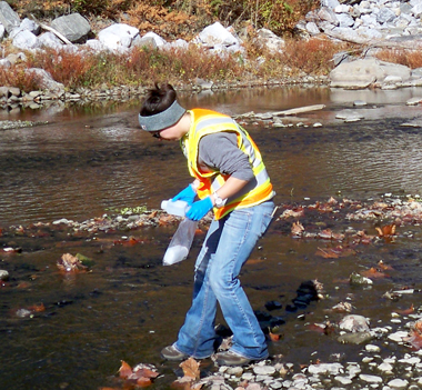 staff conducting surface water sampling