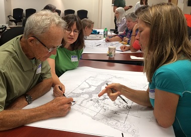People reviewing a site plan map