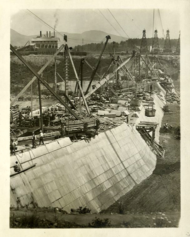 Construction for Ashokan Reservoir. View of Olive Bridge dam showing down-stream face of masonry section. Stone crusher and concrete mixing plant in left background. June 21, 1910.