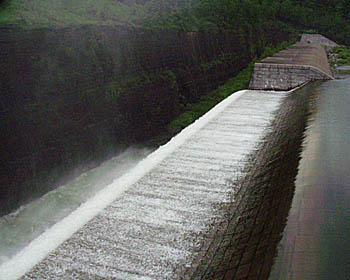 A photo of the Canonsville Reservoir spilling water