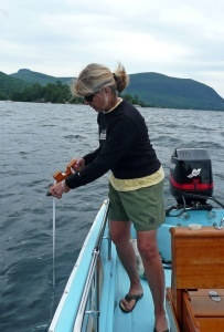 CSLAP volunteer measuring the depth of water clarity with a secchi disk.