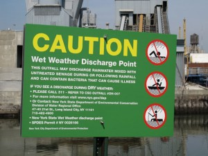 Combined sewer overflow (CSO) sign advising people to avoid contact with the waterbody during and following wet weather events.