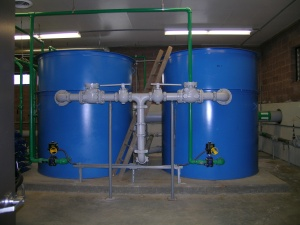 Two large blue tanks for chemical usage and storage