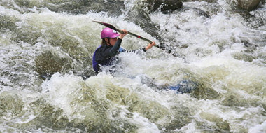 image of Kayaker in whitewater
