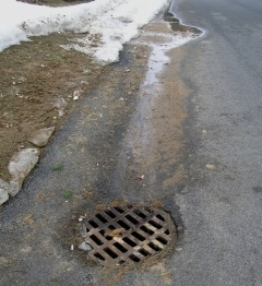 snowmelt runoff flowing into storm drain