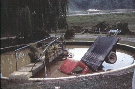 photo of truck in clarifier from a flood