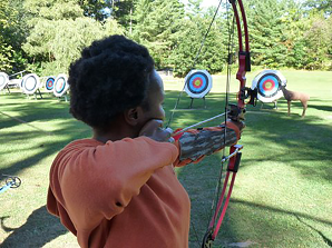 woman practicing archery with targets