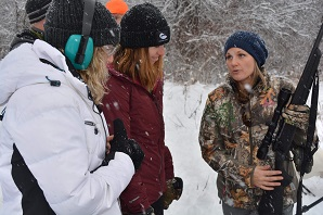 women learning rifle basics from female instructor