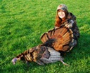 Successful junior hunter with wild turkey