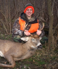 image of Joshua Shafer with his first deer taken in Columbia County, 2010