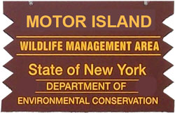 Motor Island Brown Sign