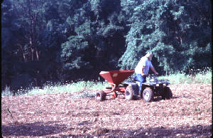 Picture of seeding food plot with atv mounted seeder