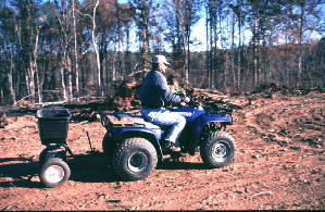 Picture of planting food plot using atv mounted equipment